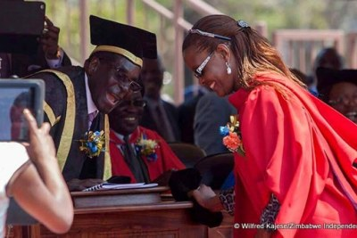 The late former president Robert Mugabe caps former First Lady Grace Mugabe at her graduation.