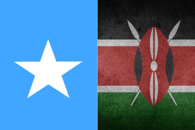 Somalia flag, left, Kenya flag
