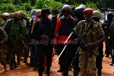 NUP presidential candidate Robert Kyagulanyi aka Bobi Wine being led to a waiting army chopper in Kalangala town, December 30, 2020. Police say they intended to escort him to his home in Magere, Wakiso district.