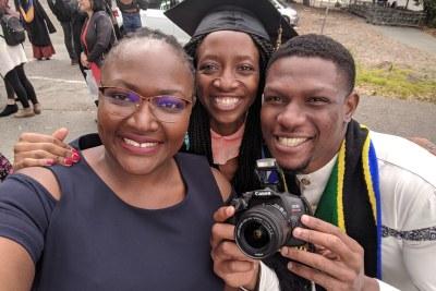 KaziTu_Co-founders: From left to right: Mastercard Foundation Scholars Sarah Lebu (Kenyan), Kwinoja Kapiteni (Tanzanian), and Chidi Uwaeme (Nigerian) during a graduation ceremony at the University of California Berkeley in 2019.