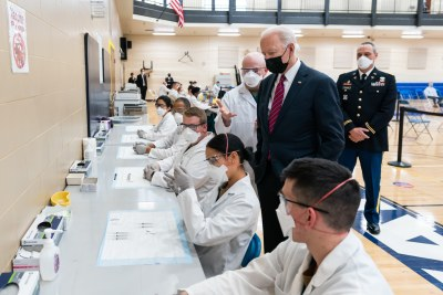 United States President Joe Biden observes dosage preparations during a tour of the vaccination center at Walter Reed National Military Medical Center in Bethesda, Maryland Friday, Jan. 29, 2021.